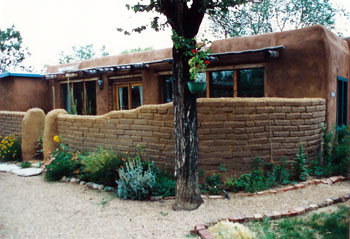 adobe home with exposed adobe privacy wall
