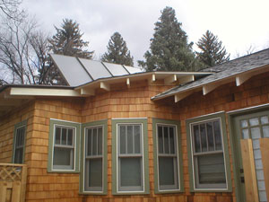 solar hot water collectors on craftsman style home